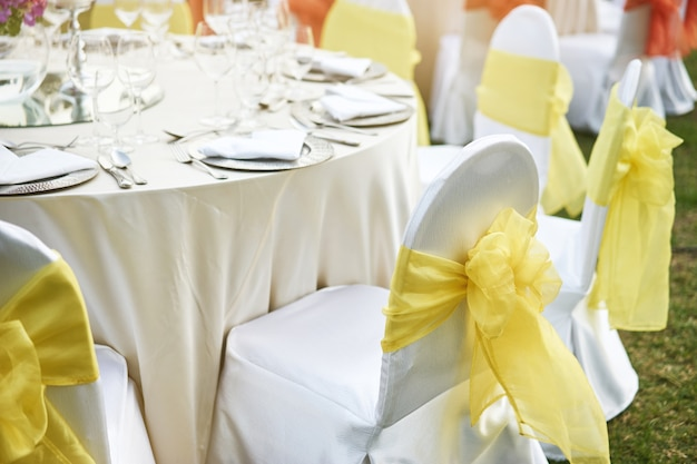 decorating ideas delectable image of wedding table.htm back of spandex white cover chairs yellow organza sash for wedding  cover chairs yellow organza sash
