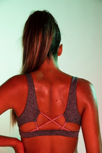 Back view of athlete with colored background Free Photo