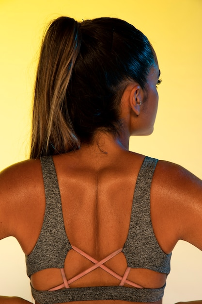 Back view of athlete and yellow background Free Photo