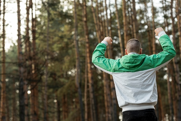 Back view athletic man working out in nature Free Photo