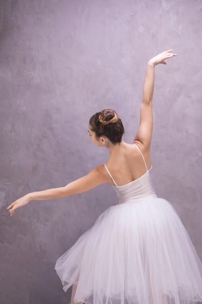 Back view ballerina posing Free Photo