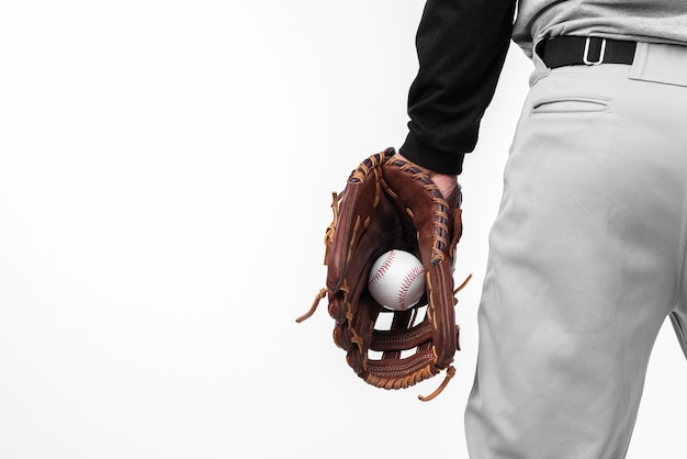 Back view of baseball held in glove Free Photo