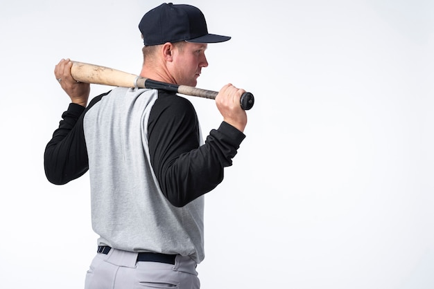 Back view of baseball player with bat Free Photo