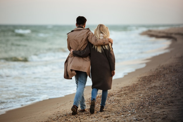 Back view of a beautiful couple in love Free Photo