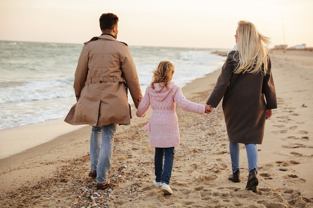 Back view of a beautiful family with a little daughter Free Photo
