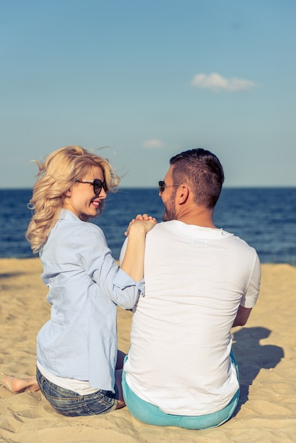 Back view of beautiful young couple on beach. Premium Photo