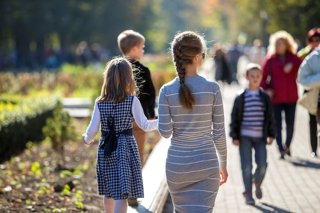 Back view of child girl and mother Premium Photo