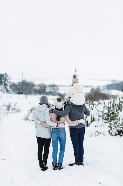 Back view family enjoying winter view Free Photo