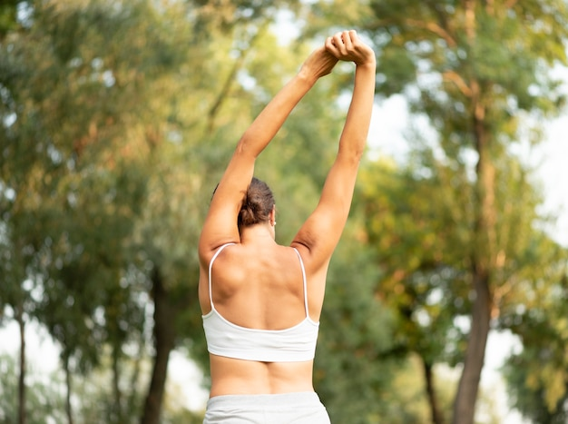 Back view fit woman stretching Free Photo