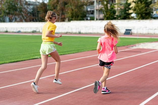 Premium Photo | Back view of girls running