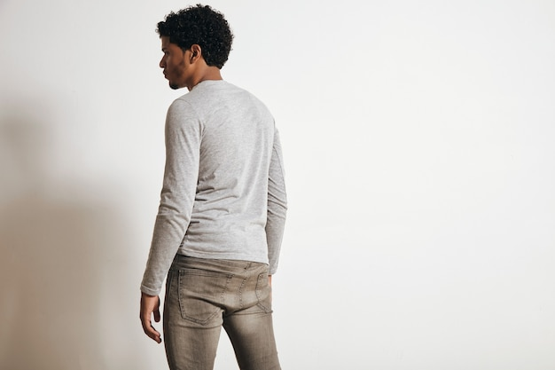Back view of latino man looking on side, isolated on white, wearing blank heather grey clothing Free Photo