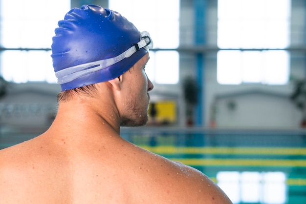 Back view male swimmer looking at pool Free Photo