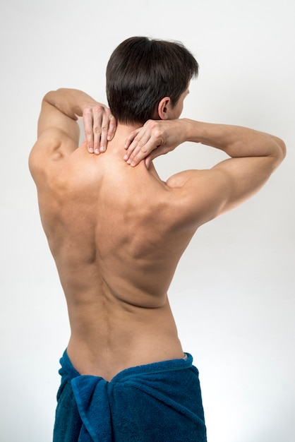 Back view man massaging his neck Free Photo
