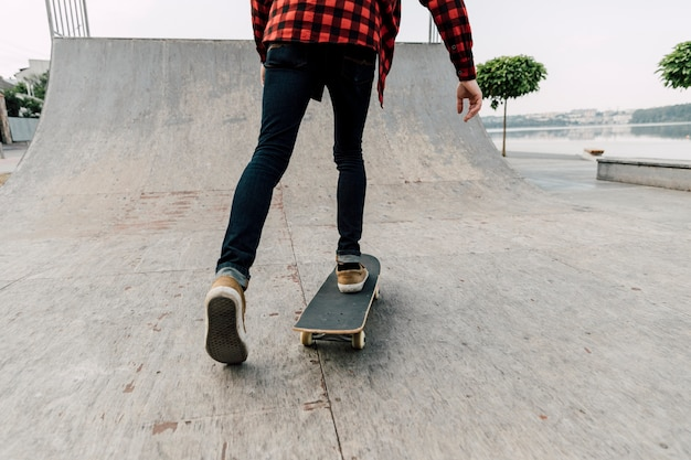 Back view of man on skateboard Free Photo