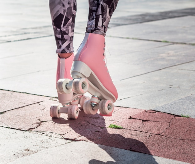 Back view of roller skates on pavement Free Photo