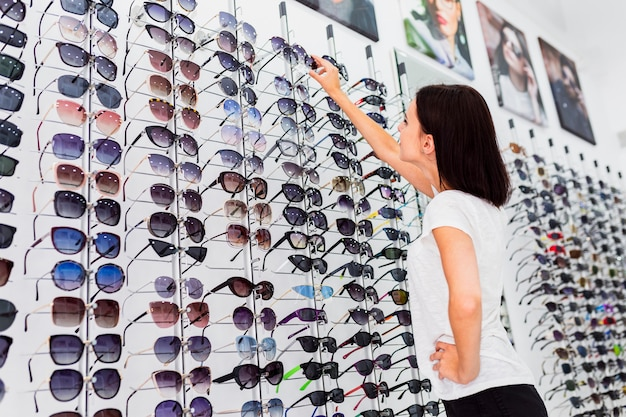 Back view of woman checking sunglasses Free Photo