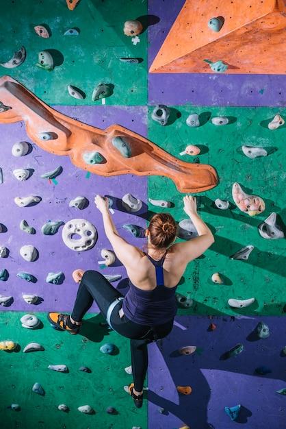 Back view woman climbing wall 23 2147795587