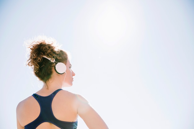 Back view woman listening music during training Photo | Free Download