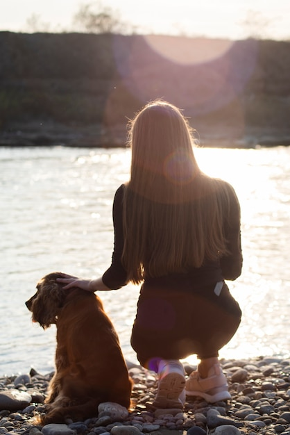 Back view young woman with her dog Free Photo