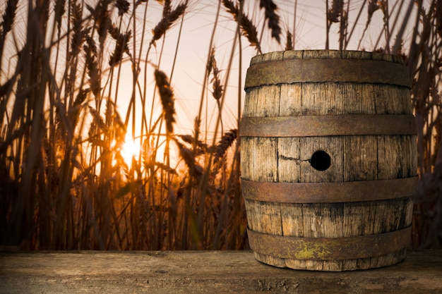 Background of barrel and worn old table of a wheat background Premium Photo