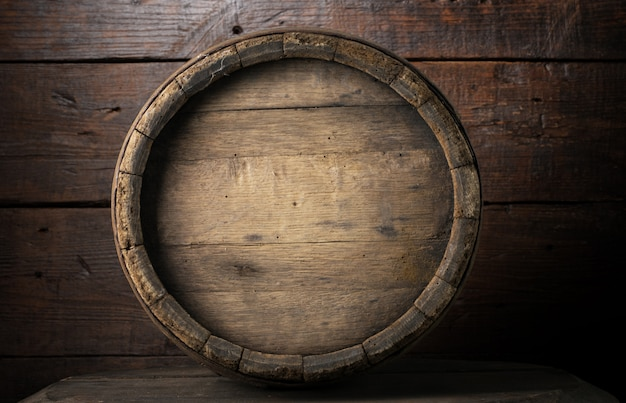 Background of barrel and worn old table of wood Premium Photo