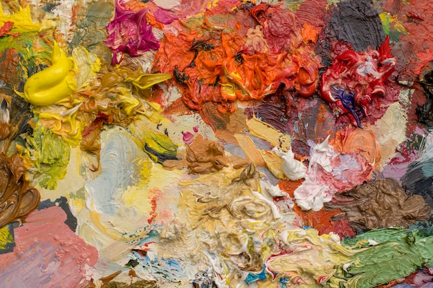 Background  of bright oil-paint palette close-up Premium Photo