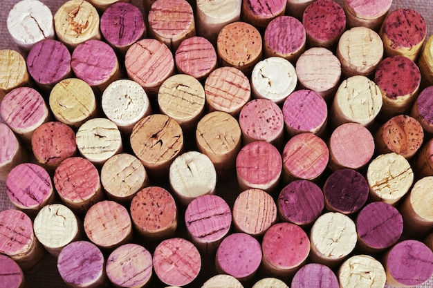 Background of  bright wine corks from red and white wine. Premium Photo
