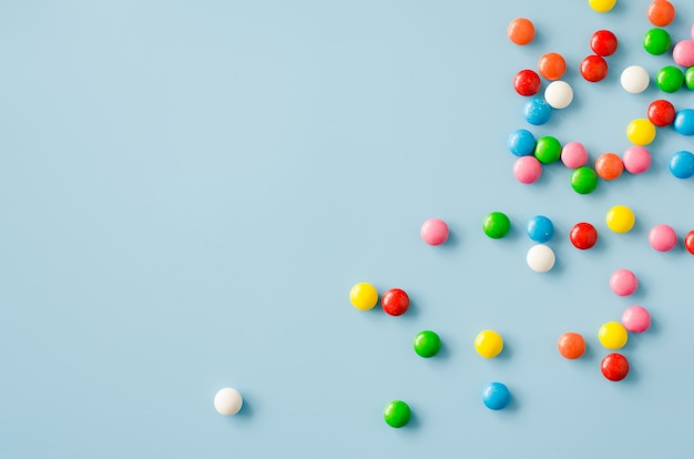 Background of chocolate candy with colored glaze Premium Photo