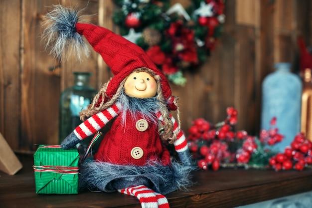 Задний план. рождественский гном. приветствие. Premium Фотографии
