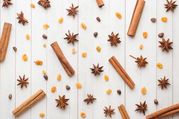 Background Of Cinnamon Sticks Star Anise Nuts And Raisins