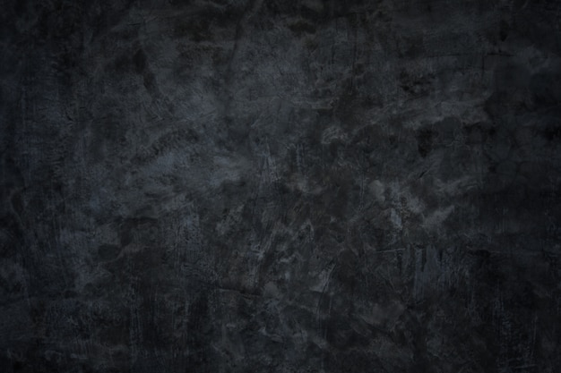 Background a dark concrete wall background Premium Photo