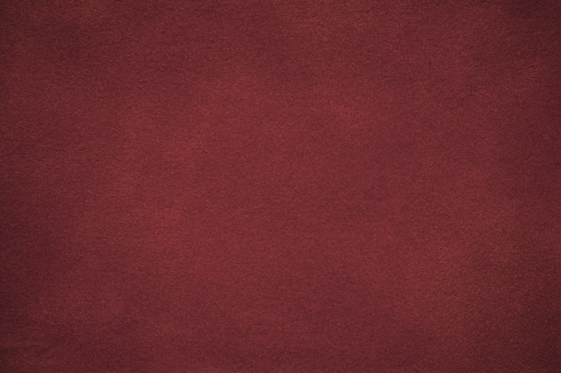 Background of dark red suede fabric Premium Photo