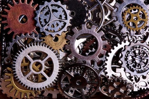 Background from various gears close-up. Premium Photo