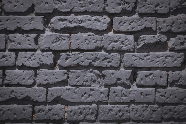 Background of a grey brick wall - great for a cool or wallpaper Free Photo
