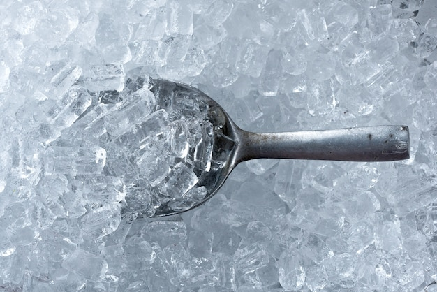 Background of ice tube and ice scoop made from metal Premium Photo