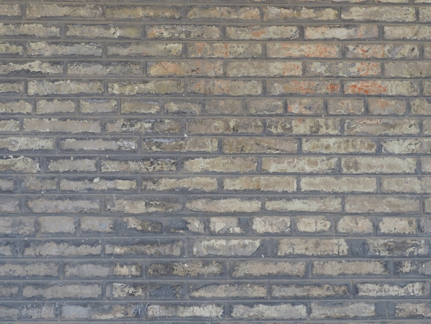 The background image of a wall made of gray brick blocks Premium Photo