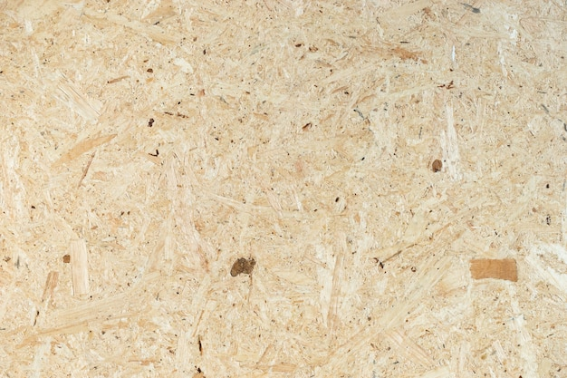 Background made from particle wooden board, yellow Premium Photo