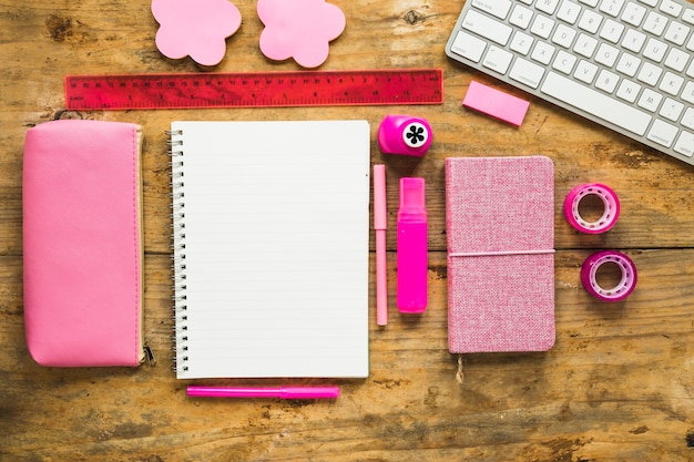 Background of notepad and colorful school supplies Free Photo