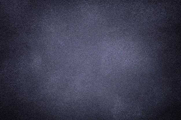 暗い灰色と青のスエード生地のクローズアップの背景。 Premium写真