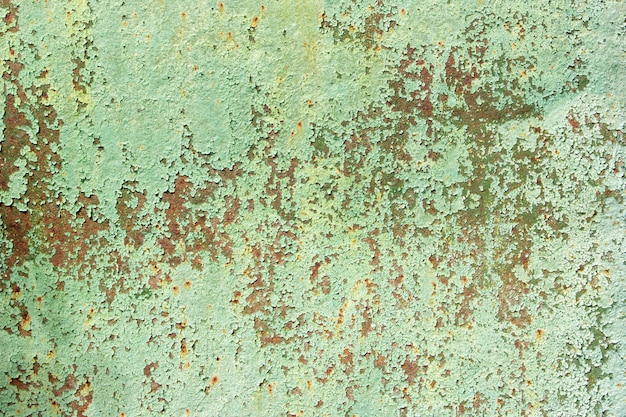 Background of old painted metal surface. rusty metal, peeling paint, green tones, bright colors. Premium Photo