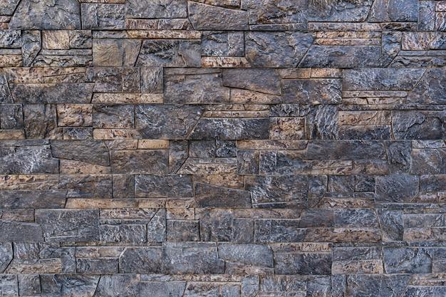 Sullo sfondo di un vecchio muro di mattoni d'epoca Foto Gratuite