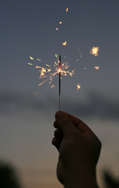 Background of people hand are playing with fire sparklers on the dark at festival. Premium Photo