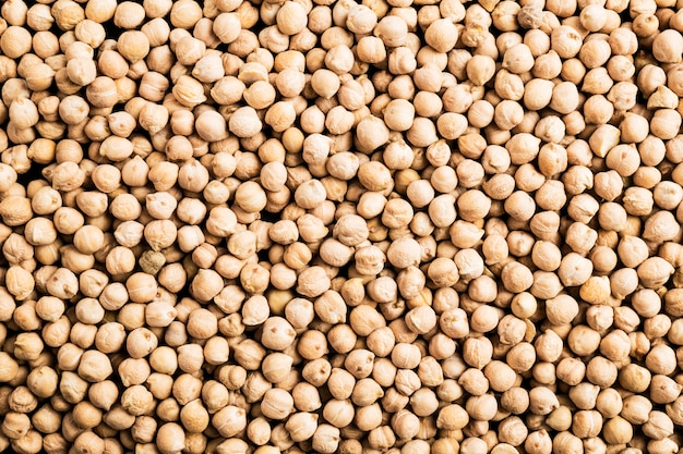 Background of raw chickpeas to use as a poster in markets or magazines Premium Photo