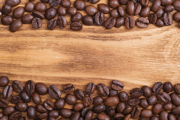 The background of roasted coffee beans is brown on wooden boards Premium Photo
