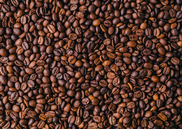 Background of roasted fresh brown coffee beans - perfect for a cool wallpaper Free Photo