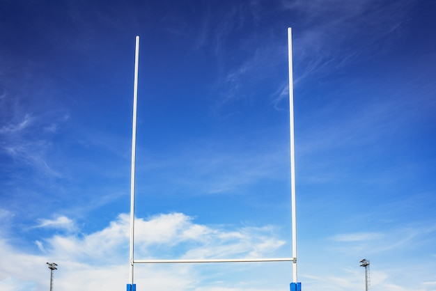 Background of a rugby goal casting shadows on the field. Premium Photo