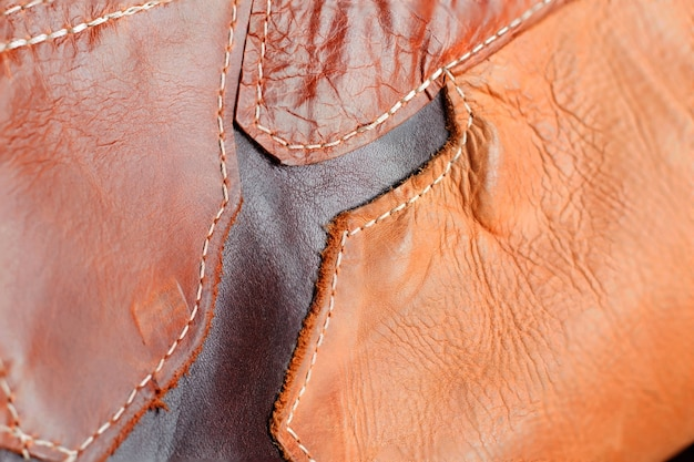 Background of sewing on leather. Premium Photo