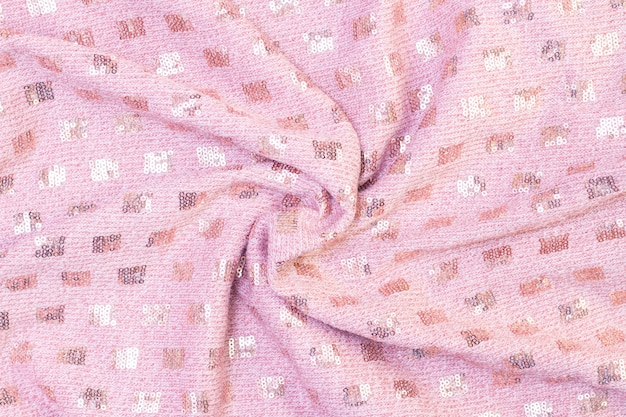 Background texture of knitted soft pink fabric with sequins. beautiful background Premium Photo