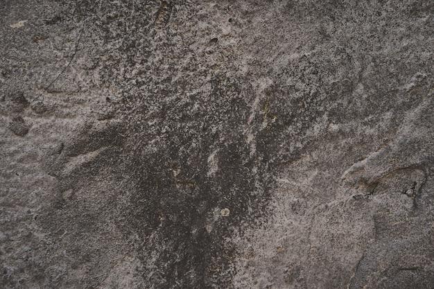 Фоновая текстура асфальта. тяжело старые окрашенные стены в стиле гранж. серый вид крупным планом Premium Фотографии