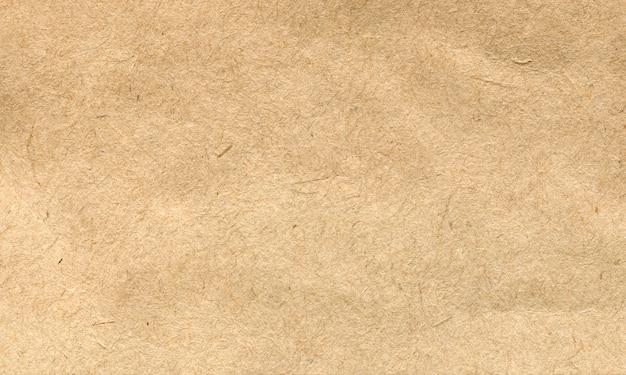 Фон текстура бумаги жёлтый оттенок Premium Фотографии